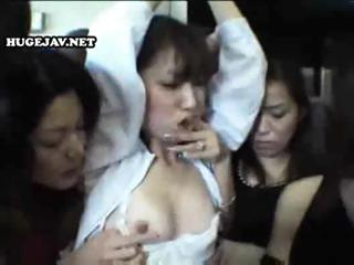 Young Asian gal gets gangbanged by a group of lesbians on the train