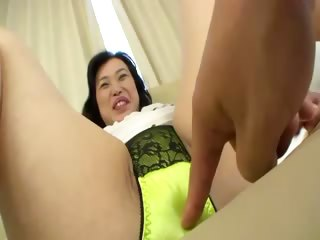 Asian milf shows her goods to her horny young stud