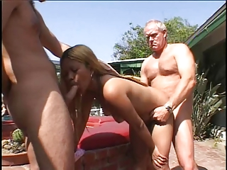 Blonde whore sucks and takes two cocks outdoors