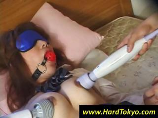 Young Oriental cutie is blindfolded and gagged then vibed through her panties